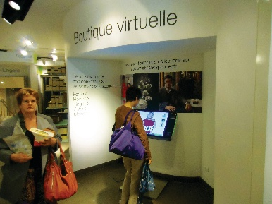 Marks and Spencer pushes its social network presence in its windows and shoppers can order products at the 'boutique virtuelle'