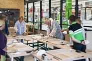 Products are displayed within a series of \'ateliers\' – practical workshops staffed by \'artisan\' makers