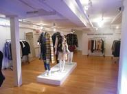The store is a white box with computer monitors on the ground floor and mannequins wearing the products in the basement.
