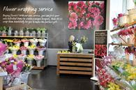 Marks & Spencer ahs been accused of charging inflated prices for products including flowers at its hospital stores