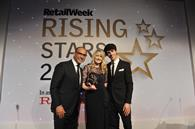 The Ryman Retail Week Rising Star of the Year was awarded to Sam Allison of Boots, pictured with Theo Paphitis and awards host and comedian, Matt Richardson.