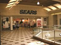 Department store group Sears plans to update its US stores after reporting an increase in revenue over the last year.