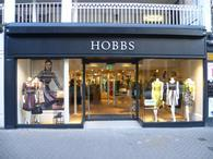 Hobbs private equity owner 3i has written down the value of its investment by 40 per cent