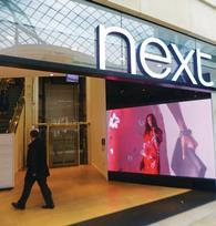 Warm September weather affected sales at Next