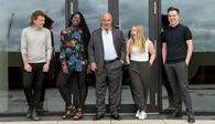 Sir Philip Green with students from the Fashion Retail Academy