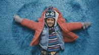 Argos\' TV ad features a series of 'real life' scenes including a child making snow angels in a deep pile rug