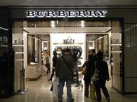 Luxury brand Burberry has warned that volatile exchange rates could hit full year profits as it revealed a quarterly sales rise.