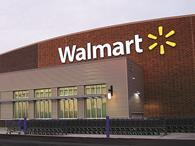 US retail titan Walmart is wielding the axe on 450 jobs at its headquarters in Arkansas as it restructures its management team.