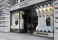Formal menswear retailer Moss Bros first half sales increased but profits slipped as it temporarily closed stores to refit them.