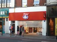 Mobile phone operator EE has acquired 58 Phones 4u shops out of administration, saving 359 jobs.