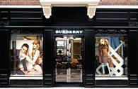 "Burberry said it faced a ""difficult external environment"" as it invests in overseas markets"