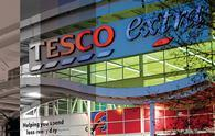 "Tesco has reported a 55% slump in profit during its first half but has hailed ""further improvement"" in like-for-like sales during its second quarter."