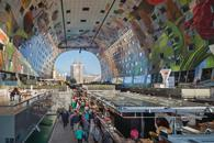 Rotterdam's Markthal boasts a market-place atmosphere that includes mainstream retail offers, all under one spectacular roof.