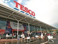 TPG is eyeing a bid for Tesco's data business Dunnhumby as a fifth executive is suspended over the grocer's profit overstatement.