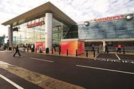 Supermarket giant Sainsbury's has pledged to pay its 137,000 store staff more than the Chancellor's compulsory national living wage.