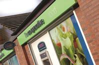 The Co-op has returned to growth for the first time in a year as grocery rival Sainsbury's reclaimed its number two spot in the market.