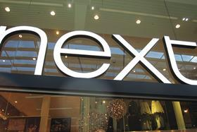 Next's quarterly sales edged down