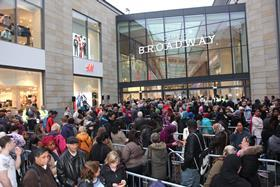 Hundreds of people queue outside The Broadway ahead of its opening on Thursday morning.