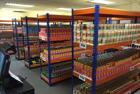 The store is only big enough for six aisles, plus a small fridge for cold drinks.
