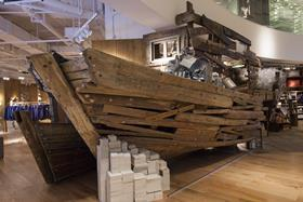The ground floor features a full-size boat crafted from driftwood