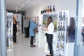 The design consists of glass wine displays and stations lined with tablets where customers can purchase wine to be delivered to their homes.