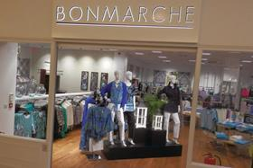 Bonmarché has reported a 15.6% drop in half-year profits after re-investing cash into opening new stores and improving its supply chain.