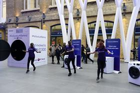 The Currys PC World dancers perform for passers-by at King's Cross station.