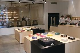 The upmarket chocolate shop has come to London with a scientific store design that gives sweet shopping a grown-up setting.