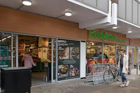 """Food wholesaler and retailer Booker has reported a 10% rise in half-year pre-tax profits despite the """"challenging"""" trading environment."""