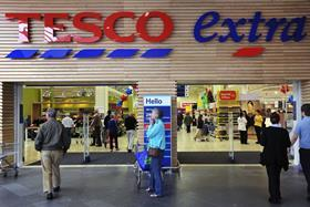 Tesco has agreed to pay US investors $12m in the wake of its accounting scandal