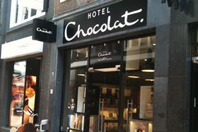 Hotel Chocolat has swung to a full-year profit driven by tighter control of costs and sales growth within its stores and online