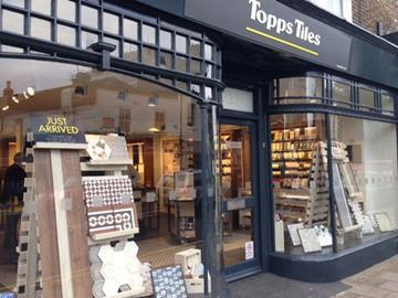 Topps Tiles has reported a rise in full-year sales and profits as it captured one third of the tile market.