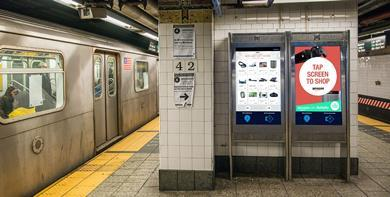 Amazon is launching transactional adverts on interactive digital kiosks on the New York subway over the Christmas period.